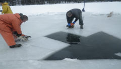 Chainsawing Through The Ice